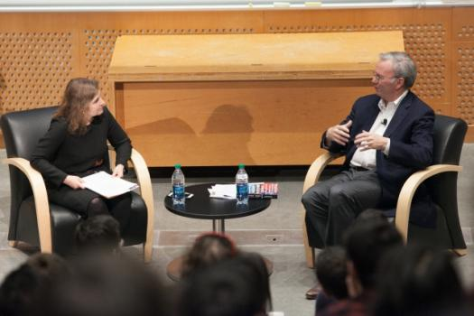 MIT Professor Daniela Rus (left), director of the Computer Science and Artificial Intelligence Laboratory, speaks with Alphabet's Eric Schmidt.