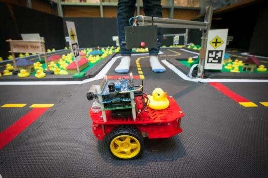 "The goal of MIT's ""Duckiebot"" class was to create a fleet of 50 self-driving taxis that can navigate the roads of a model city with just a single on-board camera and no pre-programmed maps."