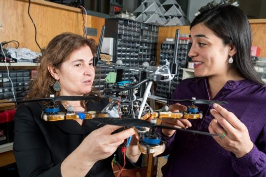 Researchers including MIT professor Daniela Rus (left) and research scientist Stephanie Gil (right) have developed a technique for preventing malicious hackers from commandeering robot teams' communication networks.