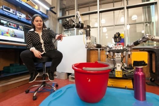 MIT doctoral candidate Claudia Pérez-D'Arpino discusses her work teaching the Optimus robot to perform various tasks, including picking up a bottle.