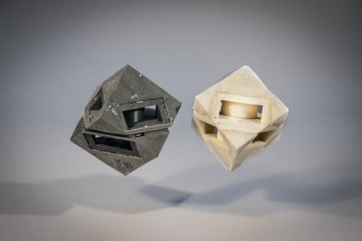 "MIT researchers outfitted their cube robot with shock-absorbing ""skins"" (left) that transfer less than half of the energy that would normally be transferred to the ground."