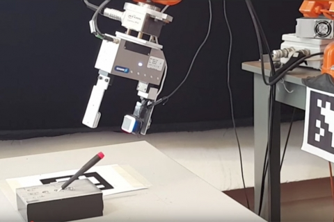 A GelSight sensor attached to a robot's gripper enables the robot to determine precisely where it has grasped a small screwdriver, removing it from and inserting it back into a slot, even when the gripper screens the screwdriver from the robot's came