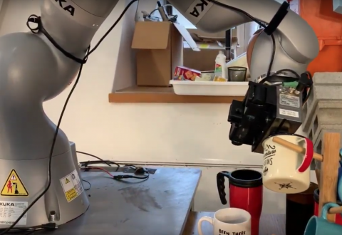 Robot hanging mug by hook